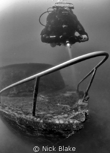 Wreck of small cruiser and diver. Wraysbury, UK by Nick Blake