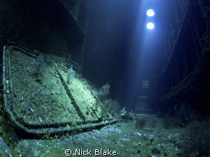 Interior of the wreck. Light penetrates through the hull... by Nick Blake
