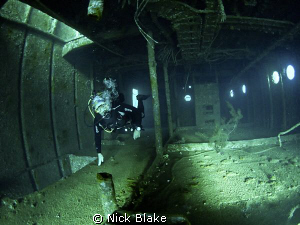Exploring inside the wreck, Red Sea. by Nick Blake