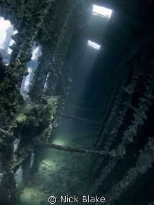 sunlight shines through the wreck of the Carnatic by Nick Blake