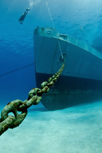 Bow and anchor chain of the USS Kittiwake; a natural ligh... by Paul Colley