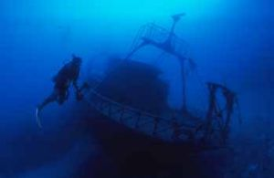 Diver + wreck by Hossam M. Nasef