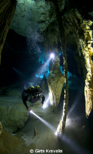 Diver in Cenote Dos Ojos. by Girts Kravalis