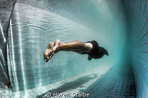 Freediving competition in swimming pool / Dahab by Horen Stalbe