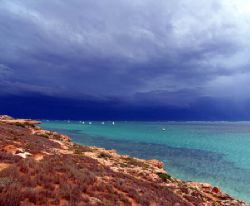 Storm clouds over Coral Bay, Western Australia by Penny Murphy
