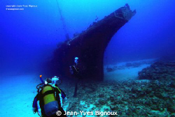 The Stella Maru ,diver coming on to the wreck.Mauritus by Jean-Yves Bignoux