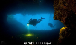 Divers in cave exploration by Nikola Hrzenjak