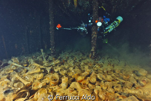 Bengasi Wreck  one of the holds of the wreck carrying gl... by Ferrucci Aldo