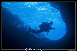 The diver at enter the cove by Ahmet Yay