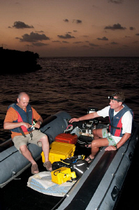 Preparing for a night dive in the South Atlantic by Paul Colley