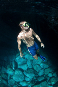 Natural light image of a snorkeler diving in the South At... by Paul Colley
