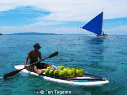 Selling coconut water to tourists under the heat of the s... by Jun Tagama