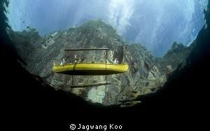 Boat & Mountain outside Water by Jagwang Koo