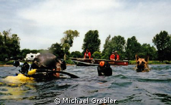 """A diver works to help train a cadaver dog. Once """"found"""" b... by Michael Grebler"""