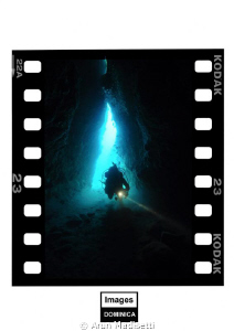 Diver entering the cave at Pointe Guignard by Arun Madisetti
