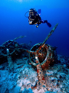 Deep dive to a sunken italian bomber airplane from the 2n... by Rico Besserdich