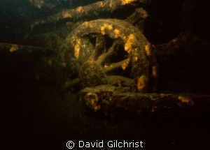 Wide angle close-up of one of the wheels on submerged loc... by David Gilchrist