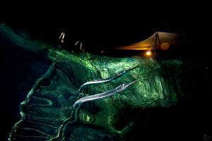 Snells window & night reflections near the dive platform.... by Rico Besserdich