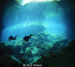 Exploring in Ponderosa Cenote, Yucatan, Mexico. by Nick Blake