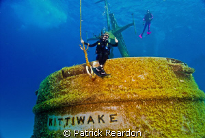 My daughter, Jenny, on the back rail of the Kittiwake, Gr... by Patrick Reardon