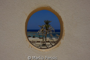 Port hole to the sea by Marko Perisic