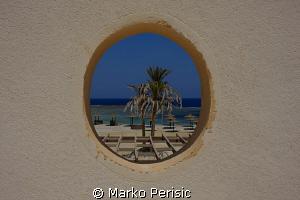 Port hole to the sea by Marko Perisic