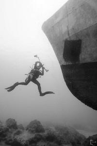 uw photographer v/s shipwreck -)  shot in B/W, natural ... by Rico Besserdich
