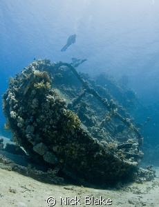 Diver & Tug Boat wreck, Red Sea South by Nick Blake