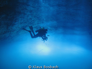 Diver (Girts Kravalis) floating over toxic Hidrogen Sulfi... by Klaus Bosbach