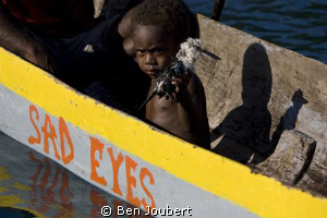 This boy was showing us his dead bird, and that combined ... by Ben Joubert