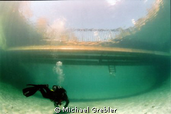 On a bright Sunday afternoon, a diver approaches the floa... by Michael Grebler
