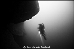 Out of nowhere, this diver came back from a deep dive as ... by Jean-Marie Brulhart
