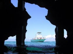 Dive boat shot from inside the wreck of the Saponna, Bimini by Don Bruschera