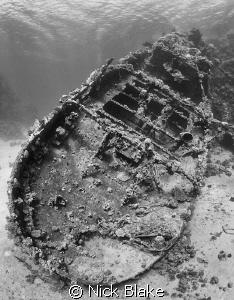 a shot of the Tug Boat wreck, Abu Galawa with black and w... by Nick Blake