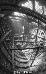 A shot inside the tug boat wreck, Red Sea by Nick Blake