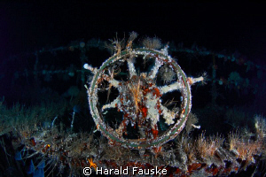The beautiful steering-wheel, standing in the open bridge... by Harald Fauske