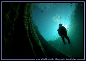 My wife diving the Verzasca River... :O)... by Michel Lonfat