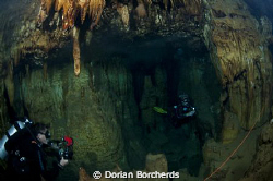 What a pretty cave. Kim and Karen having a great  dive. by Dorian Borcherds