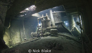 Interior view of Tug Boat wreck, Abu Galawa, Red Sea. by Nick Blake