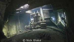 Interior view of Tug Boat wreck, Abu Galawa, Red Sea. by Nick Blake