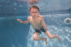 My son in the pool in early April he froze so Daddy could... by Michael Shope