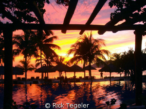 Zihuatanejo sunset.  Enjoy! by Rick Tegeler