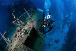 Videographer shooting the Marcha Fushi wreck