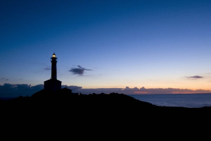 The lighthouse Favaritx on the north coast from the beaut... by Roland Bach