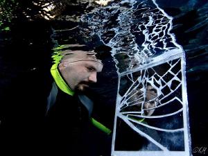 Portrait of a broken mirror under water. Taken in swimmi... by Veronika Matějková