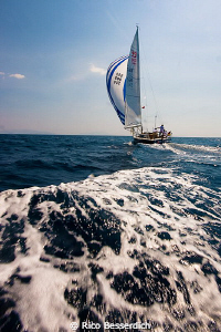 Yacht race rehearsal ( and me behind them, following in a... by Rico Besserdich