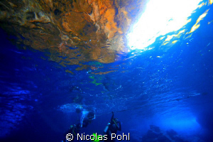 A Nice Golden Sunset glowing the Cave Rocks above the Sur... by Nicolas Pohl