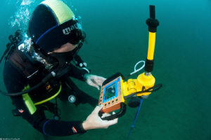 marine biologist working with a underwater acoustic telem... by Mathieu Foulquié