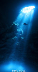 Diver in cenote Pit by Girts Kravalis