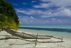 A Canoe on the beach in the New Ireland Province by Dorian Borcherds